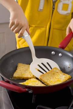 Frying French toast in a frying pan