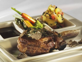 A leg of veal with truffle and a side of vegetables