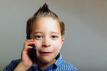 Sweet little boy talking using cell phone