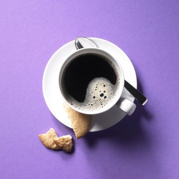 A cup of coffee and coconut macaroons