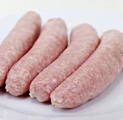 Four raw pork sausages