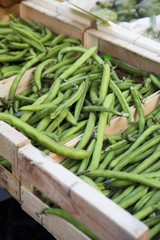 Green beans in crates at the market
