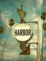 aged and worn vintage photo of harbor sign