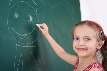girl drawing on school board
