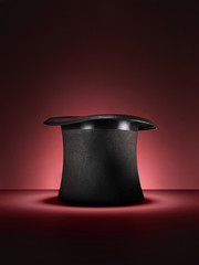magic top hat on red - Stock Image
