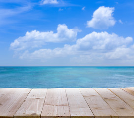 Wood table with blur  seascape and blue sky background