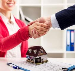 House rent and insurance agreement. Customer and agent shaking hands
