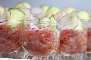 Appetizer in a glass beaker on a buffet