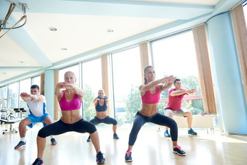 group of  people working out in a fitness gym