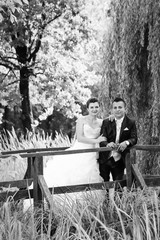 Bride and groom posing in nature bw