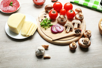 Ingredients for cooking pizza on wooden table background