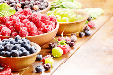 Wooden bowls with organic berries