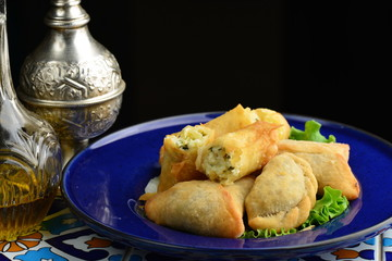 Middle eastern food fatayer stuffed with spinach and cheese