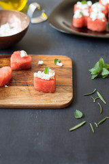 Heart-shaped watermelon with feta cheese and mint leaves. Selective focus