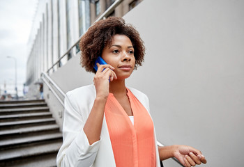african businesswoman calling on smartphone