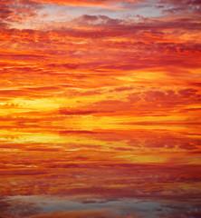 Sunset over ocean. Beautiful sunset sky. Sky Background.