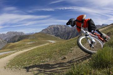 Italy,Livigno,View of man free riding mountain bike downhill