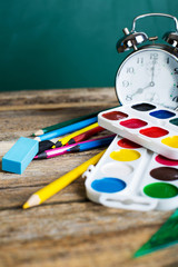 school objects. painting pictures on wooden desk