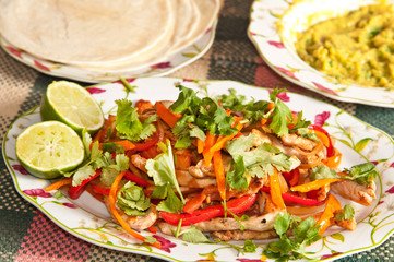 Table with tex-mex chicken fajitas ready to be prepared