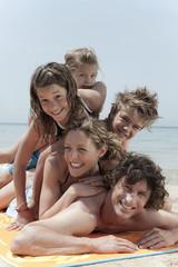 Spain,Mallorca,Family lying on beach
