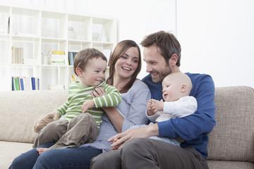 Germany,Bavaria,Munich,Family having fun in living room,smiling