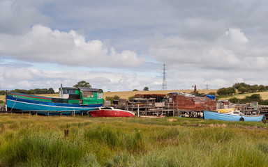 Skipool Creek, Thornton Cleveleys, Lancashire, UK. August 11th 2015. Old wooden boats at low tide at Skipool Creek, Lancashire, uk.