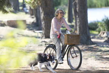 Senior woman riding on bicycle