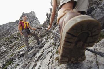 Austria,Salzburger Land,couple mountain climbing