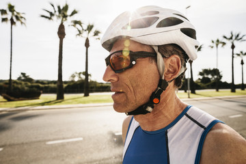 Spain, Mallorca, Sa Coma, portrait of triathlet with cycling helmet