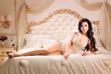 Fototapete - Beautiful and sexy woman  in bed