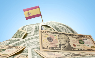 Flag of Spain sticking in a pile of american dollars.(series)