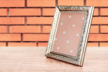 Old frame on brick wall background