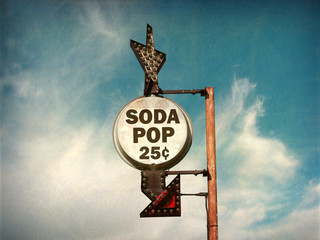 aged and worn vintage photo of retro soda pop sign