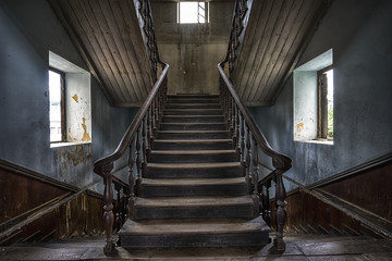 Wooden staircase in an abandoned house Wall mural