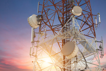 Satellite dish telecom tower at sunset