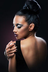 Portrait of a beautiful woman with an amazing make up, back