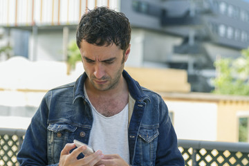 Attractive man looking his mobile phone