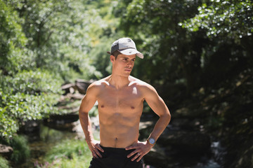 Shirtless man with peaked cap