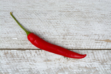 red spanish chili pepper on a old weathered wooden shelves background, with empty copy space