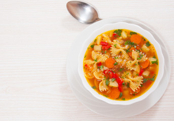 Fresh vegetable soup with farfalle pasta
