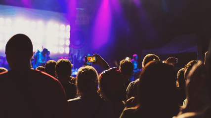 Friends taking a selfie at summer festival concert