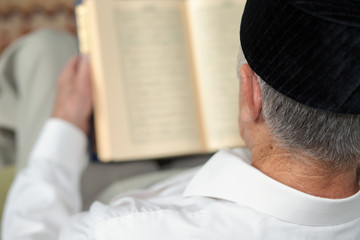 An old man reading the Koran