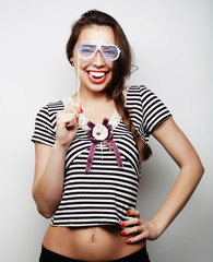 Playful young women holding a party glasses.