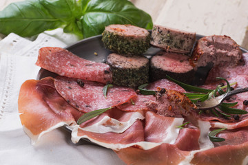 A set of various French and Italian meats on the vintage metal p