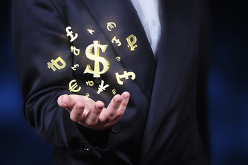 Currency gold symbols in a man hand
