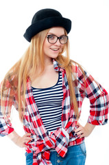 Young teenage girl in black hat, glasses and colorful clothes isolated on white background