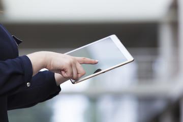 Businesswoman holding a tablet computer, closeup