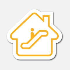 Logo maison et escalator.