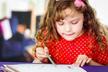 Adorable preschooler girl drawing
