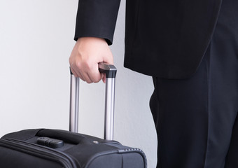 Male's hand hold baggage for travelling